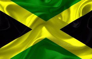 De vlag van Jamaica zul je veel zien als je op vakantie gaat naar Jamaica
